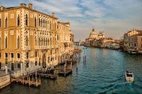 Venice, Italy - March 16th, 2019 - Palazzo Cavalli Franchetti and Santa Maria della Salute on the Grand Canal