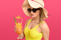 Sexy young woman holding a tropical cocktail