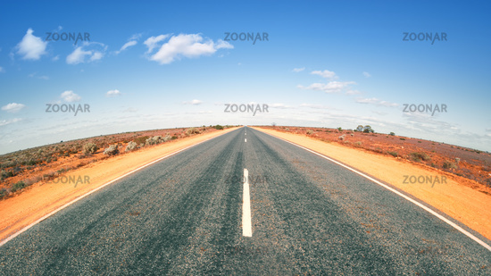 Road in Australia with curved horizon