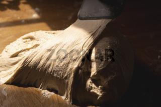 Fermented sourdough on the kitchen counter. White flour dough