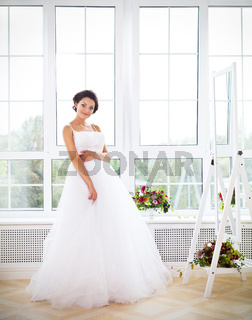 Young beautiful bride to be trying her dress