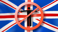 Prohibition sign with crossed out man on a background British flag.
