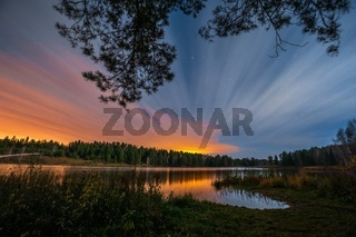 Beautiful sunset over the river and forest