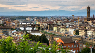 FLORENCE, TUSCANY/ITALY - OCTOBER 18 : View of buildings along and across the River Arno in Florence  on October 18, 2019.