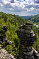 A landcape in the Elbsandstone mountains in Saxon Switzerland with forest and rock pillars