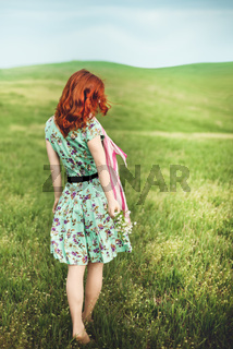 Girl standing on the green grass