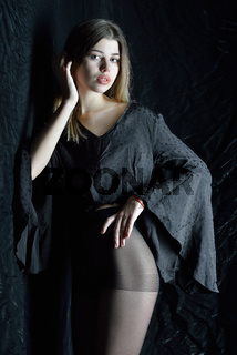 beautifil woman in black dress with long sleeves.
