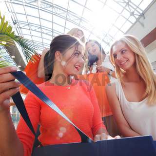 Women look inside shopping bag