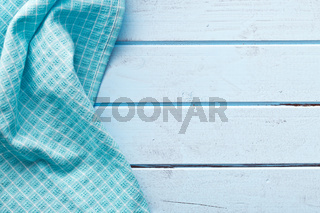 checkered napkin on blue table