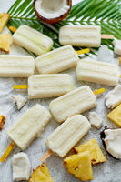 Summer popsicles on stick. Pinacolada flavour. Made with pineapple, cocount milk, rum. Vegan snack