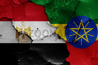 flags of Egypt and Ethiopia painted on cracked wall