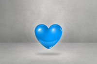 3D blue heart on a concrete studio background