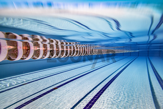 Olympic Swimming pool under water background.