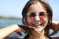 Cheerful teen girl in sunglasses