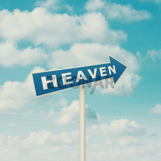 Road sign pointing to heaven