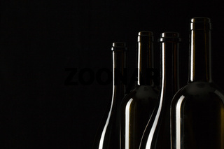 Silhouettes of elegant wine bottles
