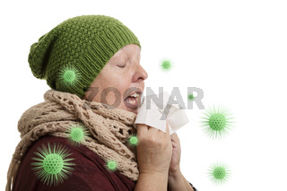 A senior woman in winter time with disease has to sneeze and blow into a handkerchief isolated on white background