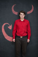Serious businessman representing the demon on grey background, sexu devil, lucifer