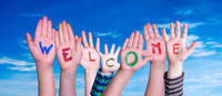 Many Different Children Hands Building Word Welcome, Deep Blue Sky