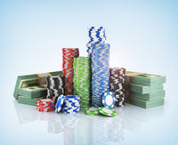 Stacks of poker chips with stack of dollars.