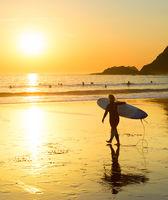Silhouette  woman surfer beach Portugal