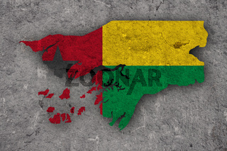 Karte und Fahne von Guinea-Bissau auf verwittertem Beton - Map and flag of Guinea-Bissau on weathered concrete
