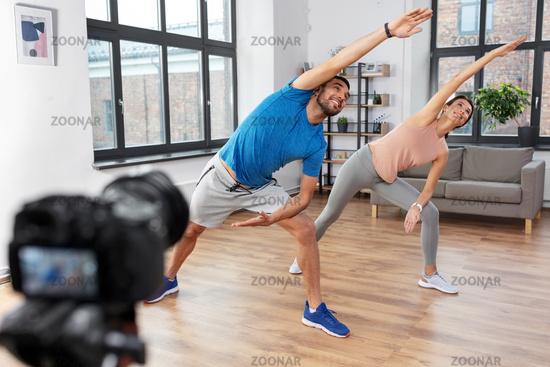 couple recording home yoga class video