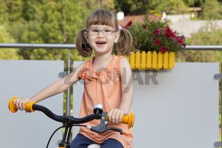 Happy girl on bike