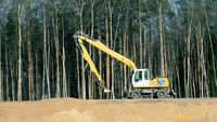 Combined road machinery - bulldozer and excavator
