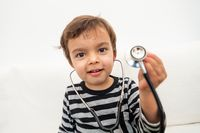 Toddler playing with stethoscope