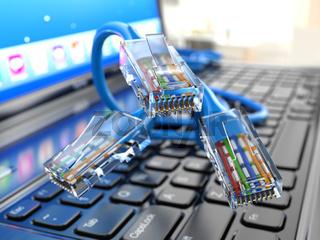 Internet concept. Laptop and ethernet cables.