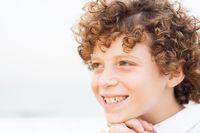 Young pretty boy posing at beach