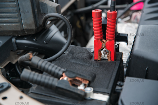 clamp on battery terminal at shallow depth of field