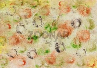 Gemaltes Aquarell mit Farbklecksen und Farbabdrücken in Rot, Gelb, Grün, Ocker, Schwarz