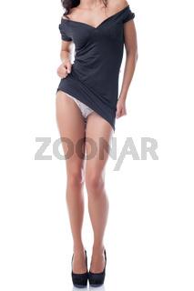 Portrait of slim sexy girl undressing in studio