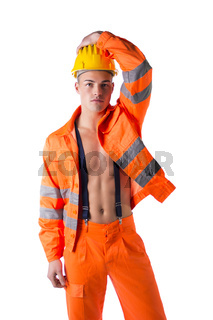 Handsome young construction worker with orange suit open on naked torso