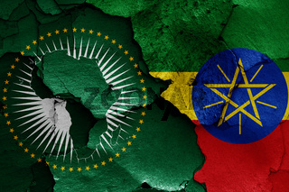 flags of African Union and Ethiopia painted on cracked wall