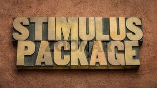 stimulus package word abstract in wood type