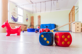 Toy foam cubes in gym hall of a pre school