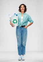 smiling young woman sorting plastic waste