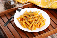 Food - Tasty Penne Pasta Plate with a Fork on Wooden Tray