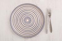 Vintage kitchen utensils plate, knife and fork.