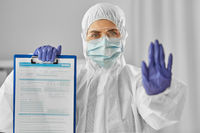 doctor in medical mask and goggles with clipboard