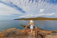 Young woman at the beach Zastani in Evia island, Greece