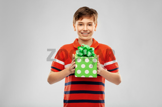 portrait of happy smiling boy with gift box