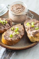 Liver pate on sliced baguette.