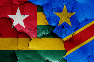 flags of Togo and DR Congo painted on cracked wall