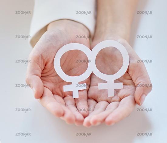 close up of happy lesbian couple with venus symbol
