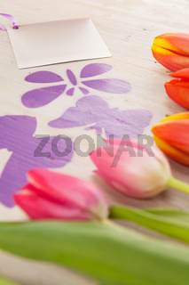Tulips and butterflies as harbingers of spring