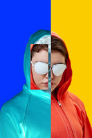 Art collage with alternative funky girl on bright blue yellow background. Close up fashion portrait young beautiful woman in hoodie and white glasses. Unusual youth fashion concept